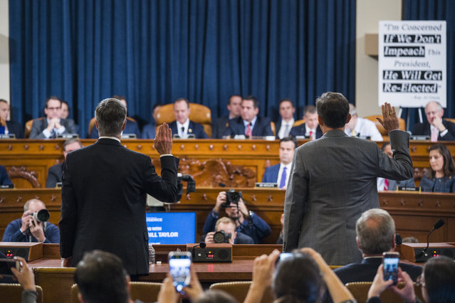 Top U.S. diplomat in Ukraine William Taylor, left, and Career Foreign Service officer George Kent are sworn in prior to testifying before the House Intelligence Committee on Capitol Hill in Washington, Wednesday, November 13, 2019, during the first public impeachment hearing of President Donald Trump's efforts to tie U.S. aid for Ukraine to investigations of his political opponents. (Photo by Jim Lo Scalzo/Pool Photo via AP Photo)