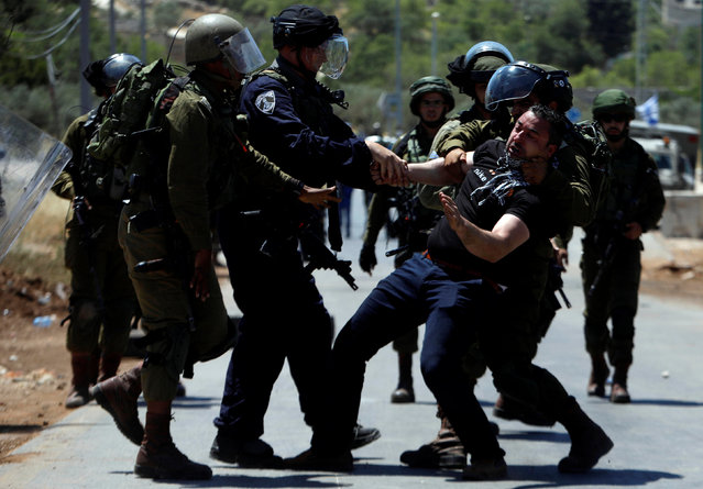 Israeli forces detain a Palestinian protester during clashes in the West Bank village of Beita, near Nablus, May 26, 2017. (Photo by Mohamad Torokman/Reuters)