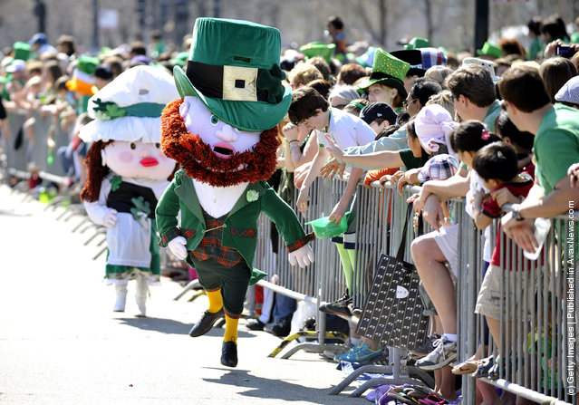 A leprachaun runs the parade route during the St. Patrick's Day parade on March 17, 2012 in Chicago, Illinois