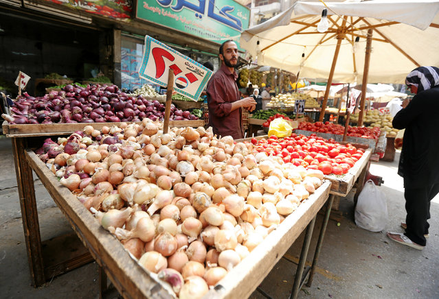 An Egyptian vegetable seller is seen at a market in Cairo, Egypt May 10, 2016. (Photo by Mohamed Abd El Ghany/Reuters)