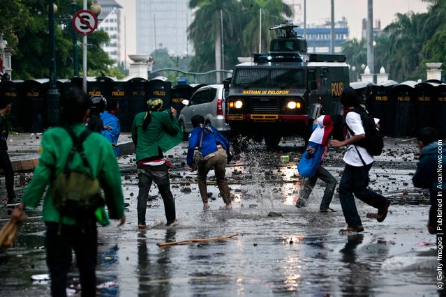 Indonesian students clash with police during protests against planned fuel price hikes in Jakarta, Indonesia