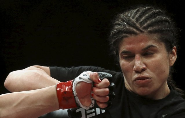 Jessica Aguilar of Mexico tries to skip a punch of Claudia Gadelha of Brazil during their Ultimate Fighting Championship (UFC) match, a professional mixed martial arts (MMA) competition in Rio de Janeiro, Brazil August 1, 2015. (Photo by Ricardo Moraes/Reuters)