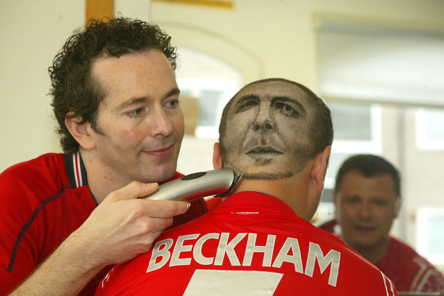 Nick Prior (34) from Bognor Regis has had his local barber, Daren Terry (left), shave a portrait of David Beckham onto the the back of his head. He says he will keep it like this as long as England are still in Euro 2004. (Photo by Southern News & Pictures)