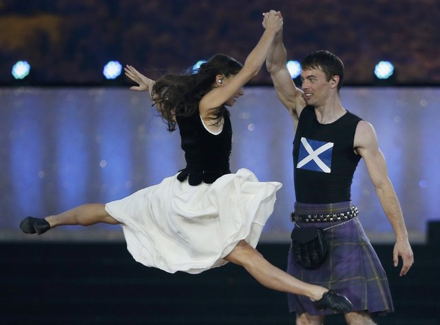 Performers take part in the opening ceremony for the 2014 Commonwealth Games at Celtic Park in Glasgow, Scotland, July 23, 2014. (Photo by Jim Young/Reuters)