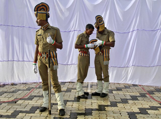 "Indian policemen get ready before the start of India's Independence Day celebrations in Kochi, India, August 15, 2015. Indian Prime Minister Narendra Modi's independence day speech focused on measures his ""Team India"" had rolled out to include millions of poor Indians in the banking and insurance systems, policies for workers and farmers and successes in the fights against inflation and corruption. (Photo by Sivaram V/Reuters)"