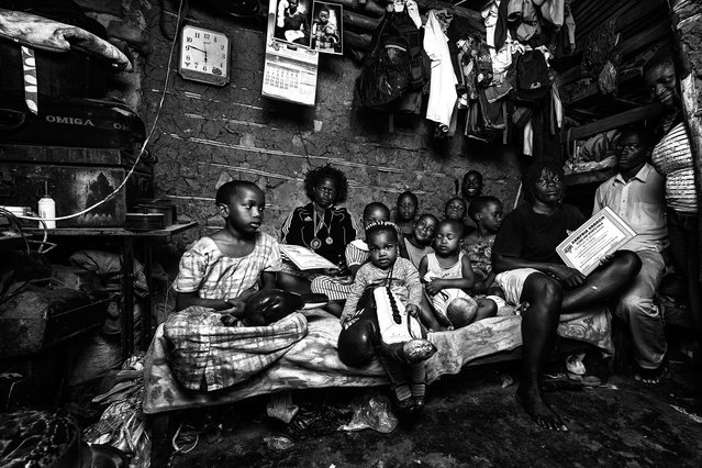 July 28, 2013 – Kampala, Uganda. Helene and Diana live with more than 25 relatives in 20 square meters with no windows, sharing the space with livestock, sleeping in bunk beds and on the floor. (Photo by Peter Bauza/ZUMA Press/VISUAL Press)