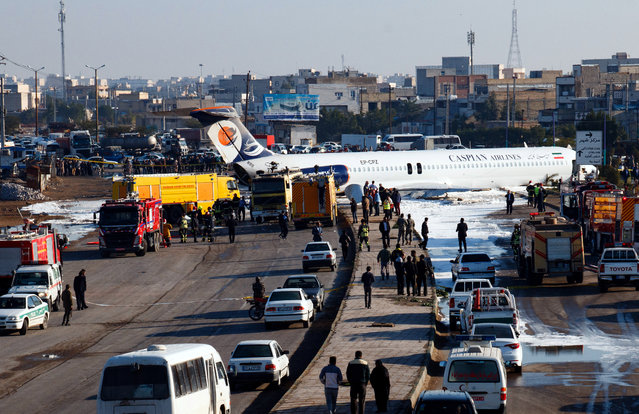 An Iranian passenger plane sits on a highway outside Mahshahr airport after skidding off the runway, in the southwestern city of Mahshahr, Iran, 27 January 2020. According to media reports the Iranian passenger plane with some 135 people on board skidded off the runway onto a road next to the airport in the southern city of Mahshahr. No one was injured in the accident, media added. (Photo by Mohammad Zarei/EPA/EFE)