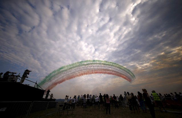 Italian Frecce Tricolori, the aerobatic demonstration team of the Italian Aeronautica Militare (Air Force) performs during the Radom Air Show at an airport in Radom, Poland August 23, 2015. (Photo by Kacper Pempel/Reuters)