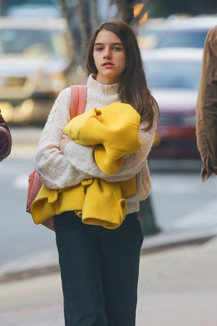 Suri Cruise walks down NYC on March 5, 2020 with her nursemaid by her side and the young daughter of Katie Holmes and Tom Cruise couldn't look more like her parents. (Photo by Backgrid USA)
