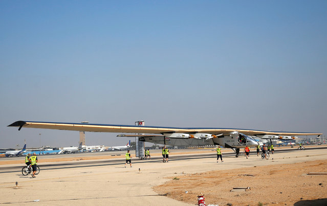 The ground crew of Solar Impulse 2, a solar powered plane, surround the aircraft after it landed at Cairo Airport, Egypt July 13, 2016. (Photo by Amr Abdallah Dalsh/Reuters)