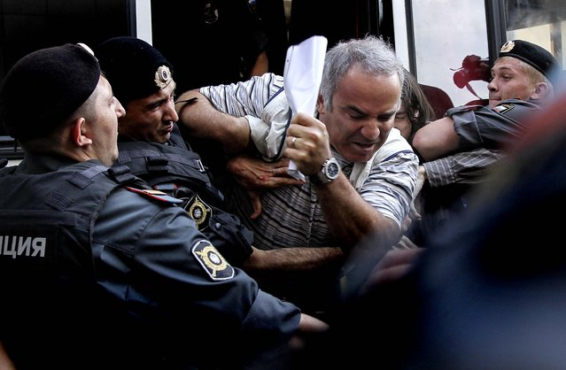 Police officers detain former world chess champion Garry Kasparov, a leading opposition activist, outside the court in Moscow. (Photo by Lisa Kessler/Associated Press)