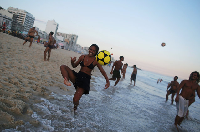 A woman controls a ball on Ipanema beach in Rio de Janeiro, Brazil, April 14, 2016. (Photo by Nacho Doce/Reuters)