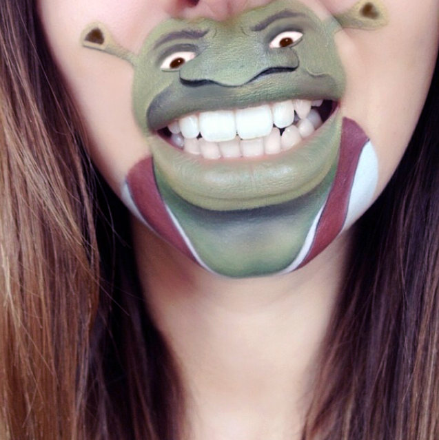 Makeup artist Laura Jenkinson paints popular cartoon characters on her face, using her own mouth as the teeth and lips of her subjects. Here, Pixar's Shreck is depicted on Jenkinson. (Photo by Laura Jenkinson/Caters News)