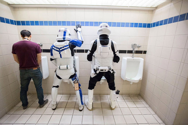 Fans dressed as Star Wars stormtroopers use toilets at Comic-Con International in San Diego, California on July 24, 2016. (Photo by Daniel Knighton/FilmMagic)