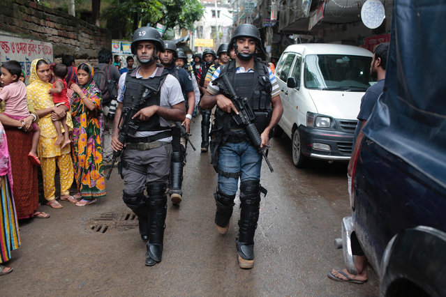 Policemen return from a raid on a building in Dhaka, Bangladesh, Tuesday, July 26, 2016. (Photo by AP Photo)