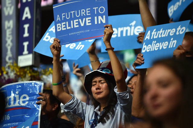 A supporter cries as Senator Bernie Sanders addresses the Democratic National Convention in Philadelphia on Monday, July 25, 2016. (Photo by Michael Robinson-ChavezThe Washington Post)