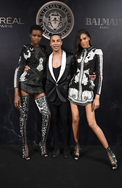 Grace Bol, Olivier Rousteingand, and Cindy Bruna attends the L'Oreal Paris X Balmain event  as part of the Paris Fashion Week Womenswear  Spring/Summer 2018 on September 28, 2017 in Paris, France. (Photo by Pascal Le Segretain/Getty Images)
