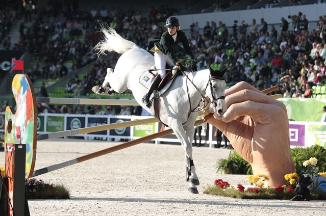 South African Cara Bianca Frew rides Leopold Pierreville on September 3, 2014 during the Individual Jumping competition of the 2014 FEI World Equestrian Games, in the northwestern French city of Caen. (Photo by Charly Triballeau/AFP Photo)
