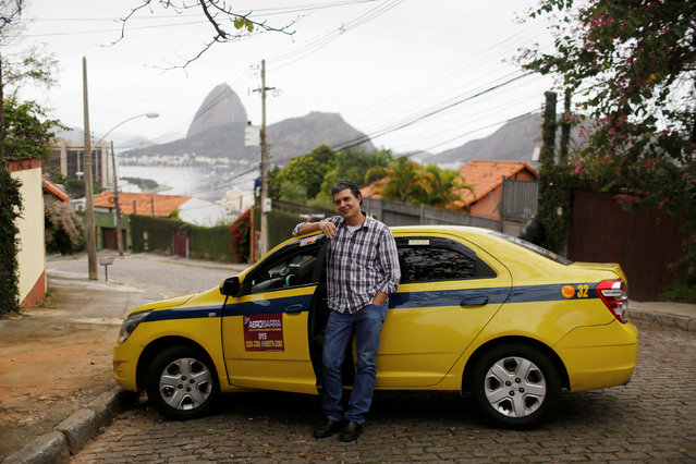 """Abner Lelis, a 54-year-old taxi-driver, poses for a portrait in Rio de Janeiro, Brazil, July 28, 2016. When asked what he felt about Rio de Janeiro hosting the Olympics, Abner said, """"I'm glad that the government has invested in improving transport and infrastructure, I spend almost the whole day driving and it's evident that traffic has improved"""". He is concerned that, """"Sometimes my colleagues, the taxi-drivers, take advantage of tourists, taking long ways to charge more in the taximeter"""". (Photo by Pilar Olivares/Reuters)"""