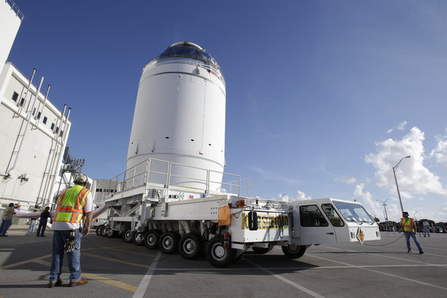 NASA's Orion spacecraft, preparing for it's first flight,  departs the Neil Armstrong Operations and Checkout Building on its way to the Payload Hazardous Servicing Facility at the Kennedy Space Center, Thursday, September 11, 2014, in Cape Canaveral, Fla. Orion is scheduled for a test flight in early December. (Photo by John Raoux/AP Photo)