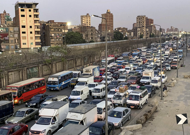 Cars are stuck in a traffic jam before hours of curfew to contain the spread of the coronavirus disease (COVID-19), in Cairo, Egypt, April 14, 2020. (Photo by Mohamed Abd El Ghany/Reuters)