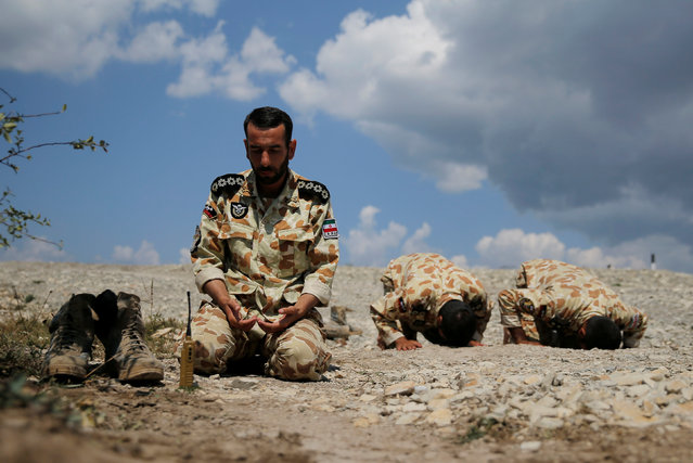 Iranian servicemen pray during the Paratrooper's platoon competition for airborne squads, part of the International Army Games 2016, at the Rayevsky shooting range outside the Black Sea port of Novorossiysk, Russia, August 8, 2016. (Photo by Maxim Shemetov/Reuters)