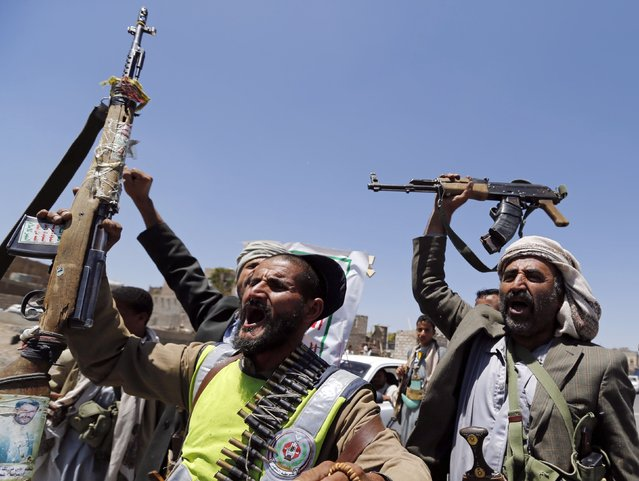 Shi'ite rebels wave their weapons at a checkpoint they erected on a street in Sanaa September 21, 2014. Shi'ite Houthi rebels and government forces fought for a fourth straight day in the Yemeni capital, residents said, despite the announcement of a U.N.-brokered agreement due to be signed later on Sunday. (Photo by Khaled Abdullah/Reuters)