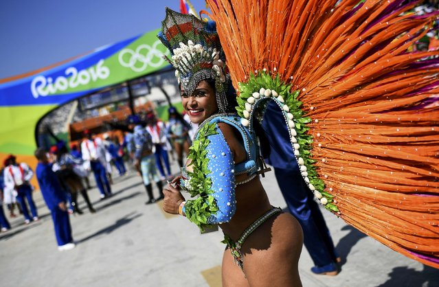 2016 Rio Olympics, Athletics, Final, Women's Marathon, Sambodromo, Rio de Janeiro, Brazil on August 14, 2016. A samba dancer reacts in Sambodromo. (Photo by Dylan Martinez/Reuters)