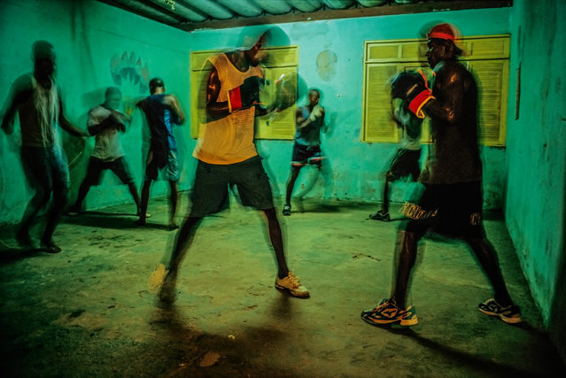 """Salvador, Bahia. """"I often shoot in the favelas in Brazil. Not to take pictures of poverty, but to show the many activities going on which show another spirit. Boxing practice in one of the favelas seemed like a good way to go. Many favelas are rich with cultural programmes"""". (Photo by David Alan Harvey/The Guardian)"""