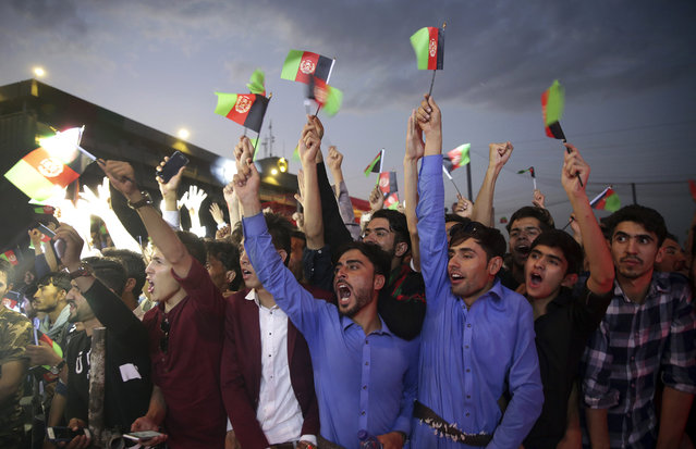 "In this August 19, 2017 file photo, fans of singer Aryana Saeed cheer, during a concert to commemorate Afghanistan's Independence Day in Kabul, Afghanistan. The annual survey by the San Francisco-based Asia Foundation. released Tuesday, Nov. 14, 2017, has found that Afghans are slightly more optimistic about the future than they were last year, despite a stagnant economy and near-constant attacks by a revitalized Taliban. The foundation acknowledged that the slight increase in optimism is ""difficult to explain"". (Photo by Massoud Hossaini/AP Photo)"