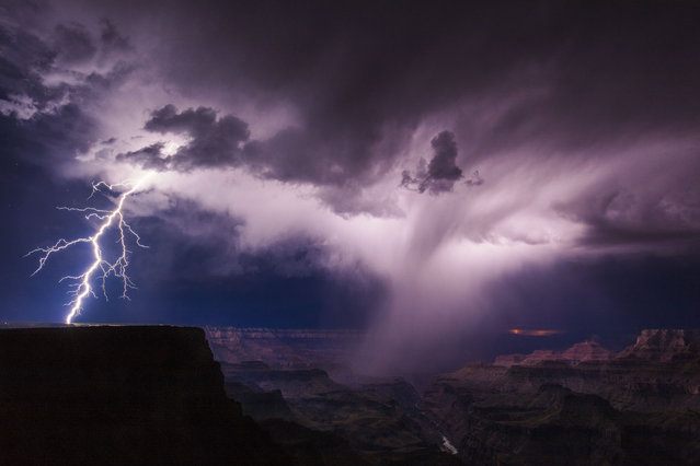 A huge positive strike lands well away from the precipitation core of this storm over the Grand Canyon, slamming in the plateau near the Villlage on September 13, 2017. (Photo by Mike Olbinski/Caters News Agency)