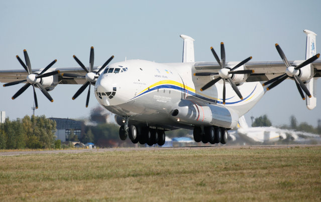 "Antonov An-22A ""Antei"" (Antheus), believed to be the world's largest turboprop-powered aircraft, takes off from the tarmac at the Antonov aircraft plant before the first commercial flight after its renovation in the settlement of Hostomel outside Kiev, Ukraine, September 8, 2016. (Photo by Valentyn Ogirenko/Reuters)"