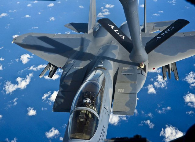 "A Florida Air National Guard F-15C ""Eagle"" takes on fuel from an Alabama Air National Guard KC-135R ""Stratotanker"" over the Gulf of Mexico off Florida on an aerial refueling flight, January 11, 2013. (Photo by Mark Almond/AL.com)"