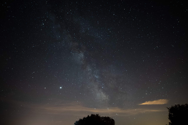 A picture taken on July 15, 2020 shows the Milky Way in Saint-Michel-L'Observatoire, southern France. (Photo by Clement Mahoudeau/AFP Photo)