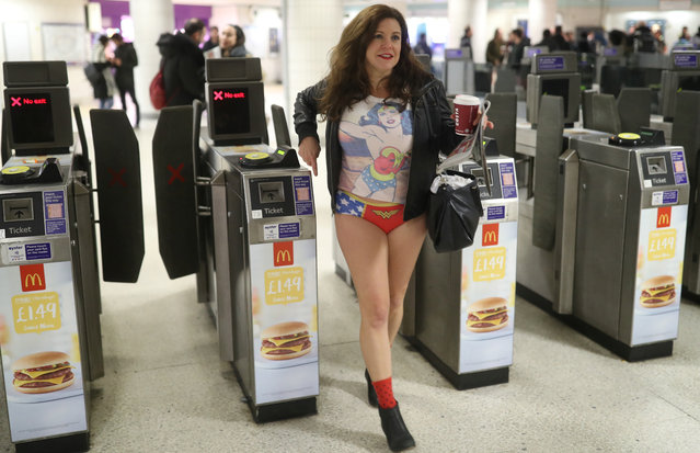 """A passenger without trousers walks through a London Underground turnstile as part of the """"No Trousers on the Tube Day"""" event, in London, Britain January 7, 2018. (Photo by Simon Dawson/Reuters)"""