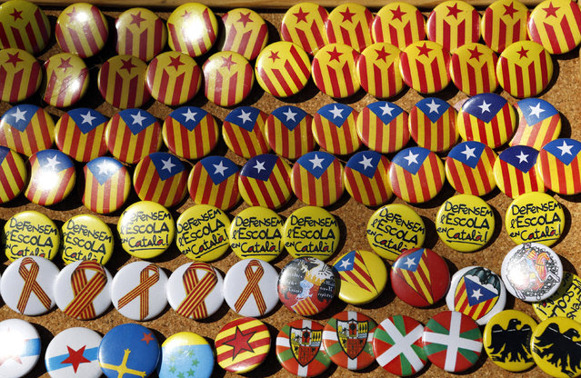 Pins are displayed in a pro Catalan independence merchandising stall in Motesquiu, April 13, 2014. (Photo by Albert Gea/Reuters)