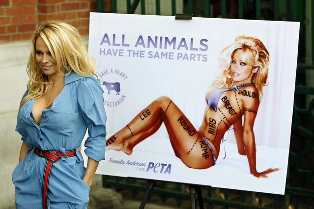 In this October 24, 2010 file photo, Canadian-born actress Pamela Anderson poses for photographers during a photocall to unveil a new advertisement in aid of People for the Ethical Treatment of Animals (PETA) in London to encourage people to go vegetarian. PETA turns 35 years old in 2015, is the largest animal rights group in world with 3 million members, and has done a lot with a little s*x, shock and celebrity. (Photo by Akira Suemori/AP Photo)