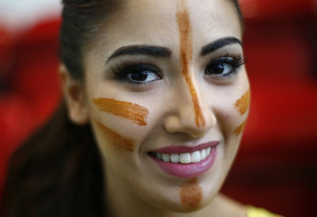 Miss Spain Lourdes Rodriguez wears face paint during the Miss World sports competition at the Lee Valley sports complex in north London, November 26, 2014. (Photo by Andrew Winning/Reuters)