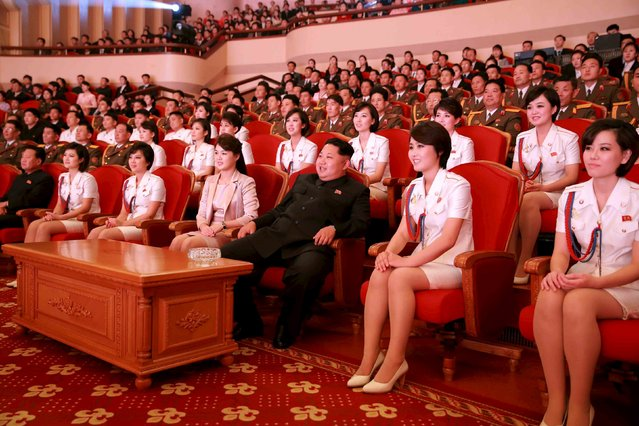 North Korean leader Kim Jong Un (3rd R) and wife Ri Sol Ju (4th L) enjoy an art performance given by the Chongbong Band to mark the 70th anniversary of the founding of the Workers' Party of Korea (WPK) in this undated photo released by North Korea's Korean Central News Agency (KCNA) in Pyongyang on October 19, 2015. (Photo by Reuters/KCNA)