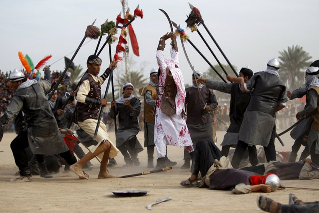 Local actors dressed as ancient warriors re-enact a scene from the 7th century battle of Kerbala during commemoration in Sadr City, Baghdad, October 24, 2015. (Photo by Ahmed Saad/Reuters)