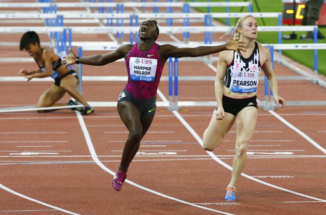 Dawn Harper-Nelson (C) of the U.S. celebrates winning the women's 100m hurdles event of the Weltklasse Diamond League meeting at the Letzigrund stadium in Zurich, in this August 28, 2014 file photo. (Photo by Arnd Wiegmann/Reuters)