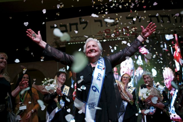 Rita Berkowitz, 83, a Holocaust survivor and winner of a beauty contest for survivors of the Nazi genocide, waves on a stage, in the northern Israeli city of Haifa, November 24, 2015. (Photo by Amir Cohen/Reuters)