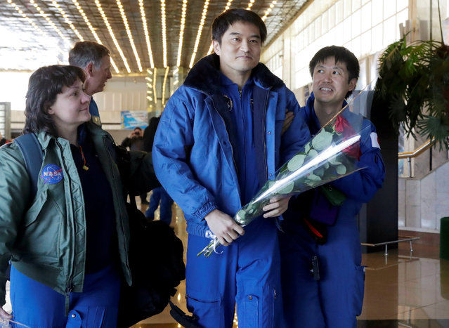 International Space Station (ISS) crew member Takuya Onishi of Japan is assisted by Japan Aerospace Agency (JAXA) and NASA space agency specialists at the airport in Karaganda, Kazakhstan, October 30, 2016. (Photo by Dmitri Lovetsky/Reuters)