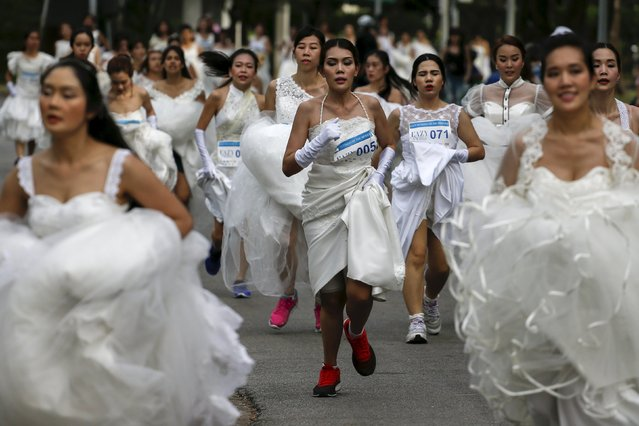 """Brides-to-be participate in the """"Running of the Brides"""" race in a park in Bangkok, Thailand, November 28, 2015. (Photo by Athit Perawongmetha/Reuters)"""