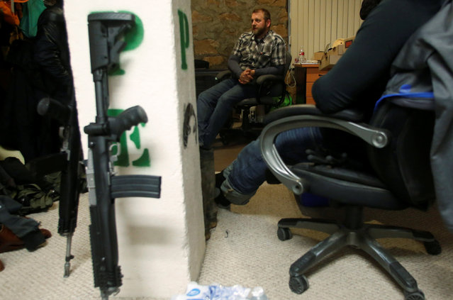 Ammon Bundy talks to occupiers in an office at the Malheur National Wildlife Refuge near Burns, Oregon, U.S. January 6, 2016. (Photo by Jim Urquhart/Reuters)