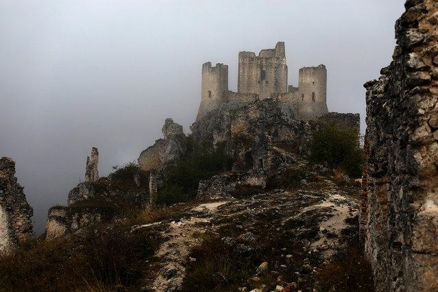 The ruins of a castle stand above the town of Rocca Calascio, close to Santo Stefano di Sessanio in the province of L'Aquila in Abruzzo, inside the national park of the Gran Sasso e Monti della Laga, Italy, September 7, 2016. (Photo by Siegfried Modola/Reuters)