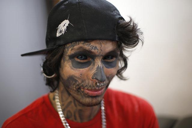 Brazilian tattoo artist Maylcoln waits for clients during Rio Tattoo Week in Rio de Janeiro, Brazil, Friday, January 16, 2015. (Photo by Silvia Izquierdo/AP Photo)