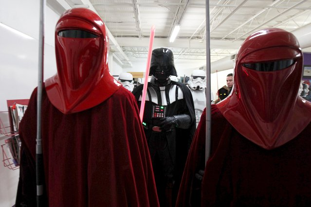 People dressed as Star Wars characters pose for a photograph during a Star Wars fan convention in Ciudad Juarez, December 5, 2015. (Photo by Jose Luis Gonzalez/Reuters)