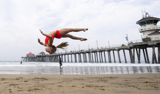 A student works on her skills during an acrobatics class near the pier in Huntington Beach, CA on Monday, August 17, 2020. Instructors at the Orange County Performing Arts Academy decided to bring the class to the beach from Anaheim Hills to beat the heat and give the students an end of the summer treat. (Photo by Paul Bersebach/The Orange County Register via AP Photo)