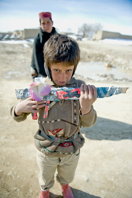 """Afghan Boy With Wooden Rifle"". Future friend or foe? Location: Paktika Province, Afghanistan. (Photo and caption by Alex Manne/National Geographic Traveler Photo Contest)"